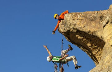 Rock climbers demonstrating trust